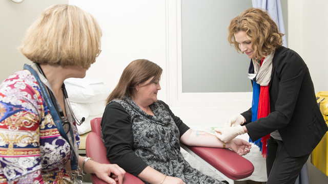 Dr Charlotte Slade takes blood for the immunodeficient blood donor initiative