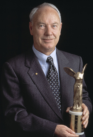 Don Metcalf holding Lasker Award
