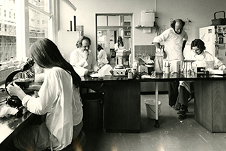 Historic photo of group of people working in laboratory